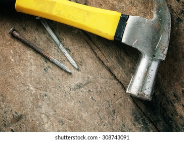 Hammer and nails on the wooden floor