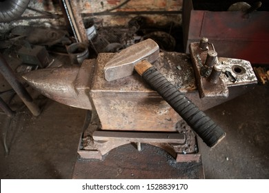 A hammer on an anvil. Hand anvil. Blacksmith tools, traditional craft. Smithy