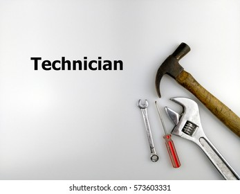 Hammer, spanner and screwdriver with text technician isolated on white background.
