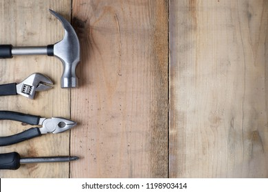 Hammer, wrench, screwdriver and pliers on a workbench
