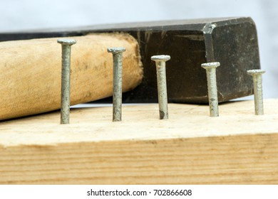 Hammered nails on a background of a hammer