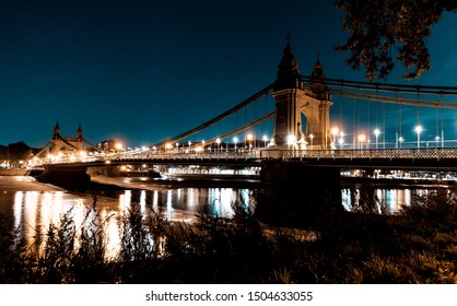 Hammersmith bridge at night taken from the Barnes side looking towards Hammersmith across the Thames