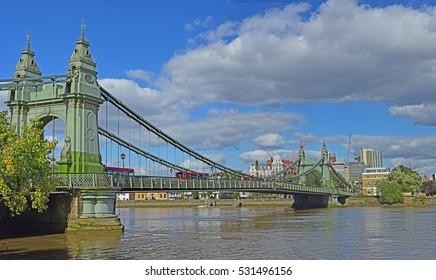 Hammersmith Bridge over the Thames in London as seen from the Thames Path National Trail in the U.K.