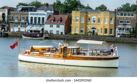 Hammersmith London  UK July 2019 A very nice boat goes up river past the blue anchor pub