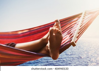 Hammock above the sea, travel and active lifestyle concept