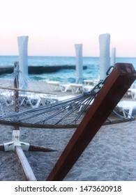hammock on the seashore closeup. Meeting dawn on the seashore.