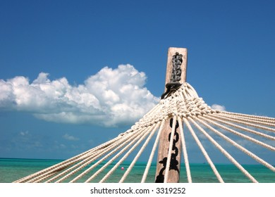 Hammock on a troipcal island in the Bahamas with the ocean and sky
