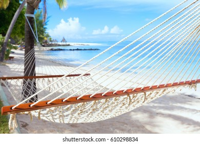 Hammock on tropical beach with palm trees  and Indian Ocean in the background