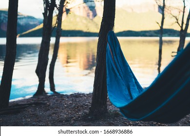 hammock for relax on background of nature lake, chilling outdoor, traveler recreation mountain landscape; camping lifestyle; enjoy weekend