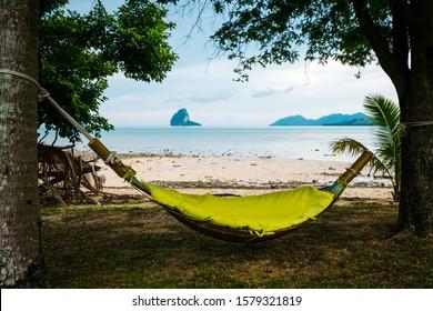 Hammock setup on a private beach on Koh Yao Noi island in Phang Nga Bay, Thailand