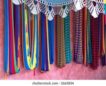 hammocks against a wall in Mexico