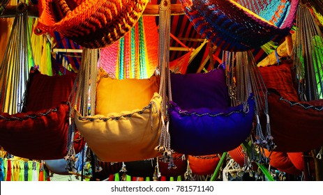Hammocks and hanging chairs on the market in India. Night bazar with handmade souvenirs in Goa. Indian flea market.