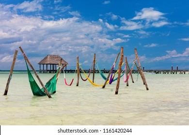 Hammocks in the water at Punta Cocos, Isla Holbox, Mexico