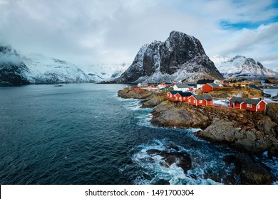Hamnoy fishing village with red rorbu houses in Norwegian fjord in winter. Lofoten Islands, Norway
