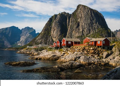 Hamnoy at sunset on the Lofoten, with the typical red houses.