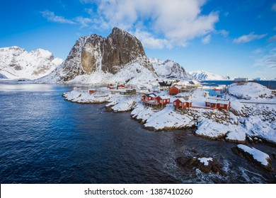 Hamnoy village in Lofoten Islands at mornig in winter, Norway, A small settlement by the sea in a quiet bay with high mountains in the background