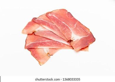 Hamon sliced on white background. Spanish traditional meat.