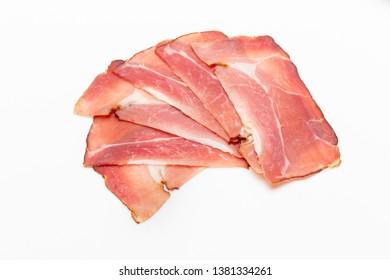 Hamon sliced on white background. Spanisch traditional meat.