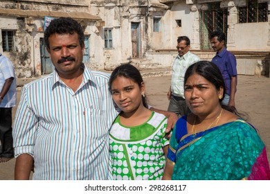 HAMPI, INDIA - 28 JANUARY 2015: Father, mother and daughter visiting the old city as tourists.