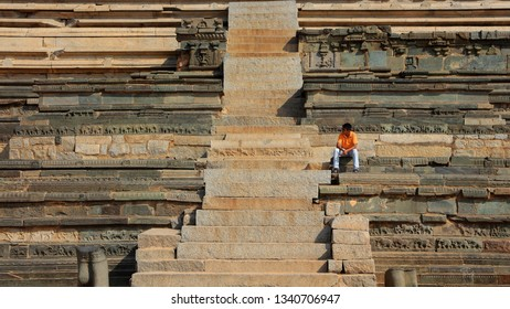 Hampi, INDIA - December 31 : Ruines of Hampi in India,  UNESCOs heritagesite a boy on the stairs of ruines, on December 31 2018, Hampi, India