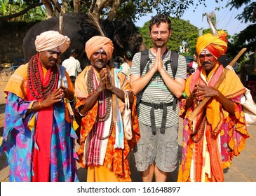 HAMPI, KARNATAKA, INDIA - APRIL 2013: Local men in traditional clothes with tourist