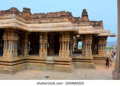 HAMPI, KARNATAKA, INDIA, NOVEMBER 2017, Visitors visits musical columns of main entrance gopuram or gate of Vitthal Temple