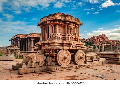 hampi stone chariot the antique stone art piece from unique angle with amazing blue sky image is taken at hampi karnataka india. it is the most impressive and truly splendid architecture in hampi.
