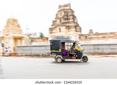 Hampi,India, 25 Aug 2018, Indians traveling by mototaxi auto rickshawor tuk-tuk.