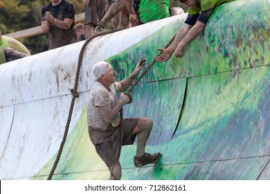 HAMPSHIRE, UK - SEPTEMBER 26, 2015: Tough Mudder is a team-oriented 18-20 km obstacle course testing strength and mental grit. It is not a timed race but a team challenge with world-class obstacles.