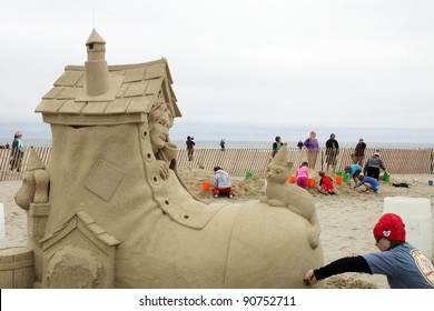 """HAMPTON BEACH, NH, USA - JUNE 28: """"There Was an Old Woman Who Sends Her Kids to Summer Camp"""" by Karen Fralich at the Master Sand Sculpting Competition on June 28, 2011 in Hampton Beach, NH, USA"""