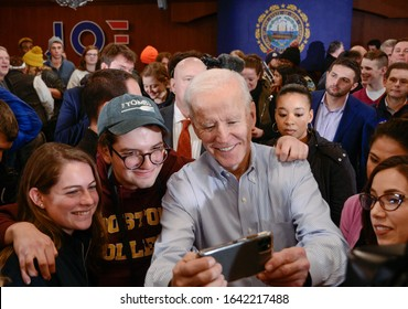 Hampton, N.H./USA - Feb. 9, 2020: Former Vice President Joe Biden takes a selfie with voters during a town hall campaign stop.