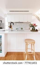 Hamptons styled kitchen with marble herringbone splash back