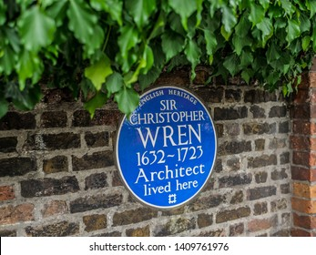 HAMTON COURT, United Kingdom - MAY 28 2019 - A commemorative blue plaque remembering English scientist and mathematician and one of Britain's most distinguished architects, Christopher Wren
