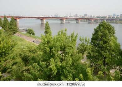 The Han River or Hangang, Seoul, South Korea, green trees, river, blue sky background, spring, summer season