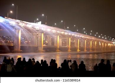 The Han River(Hangang) is a major river in South Korea. People are enjoying beautiful Seoul night under the bridge.
