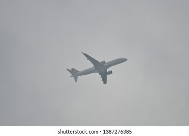 Hanau, Germany - 2019.05.03 airplane in cloudy sky approaching Frankfurt international airport