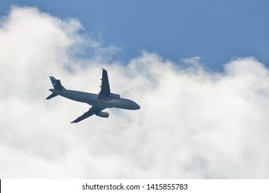 Hanau, Germany - 2019.05.10 Aegean Airlines Airbus A320-200 with registration SX-DGV airplane in blue sky approaching Frankfurt international airport
