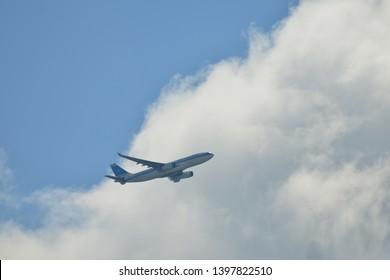 Hanau, Germany - 2019.05.10 Kuwait Airways Airbus A330 with registration 9K-APE airplane in blue sky approaching Frankfurt international airport