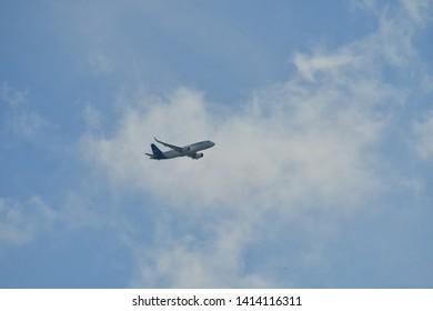 Hanau, Germany - 2019.05.10 Lufthansa Airbus A320-200 with registration D-AIWD airplane in blue sky approaching Frankfurt international airport