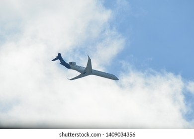 Hanau, Germany - 2019.05.10 Lufthansa CityLine Bombardier CRJ-900 with registration D-ACNL airplane in blue sky approaching Frankfurt international airport