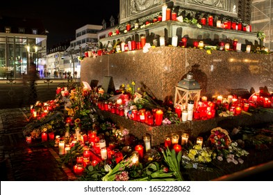 Hanau, Germany - February 20 2020: Flowers and Candles at the Hanau shooting site as a remembrance to the victims. Right extremism. Terror attack.