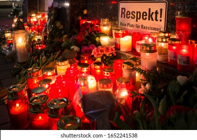 Hanau, Germany - February 20 2020: Flowers & candles as a tribute to the victims of mass shooting in Hanau, Germany by a right extremist.