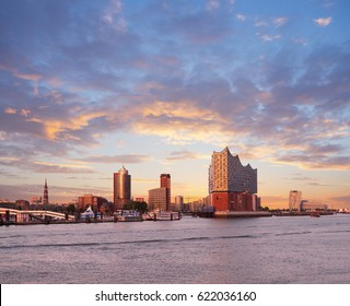 HANBURG, GERMANY- AUGUST 12, 2015: Hambirg, view on the Elbe river towards Elbphilharmonie, a concert hall in the Hafen City at sunset.