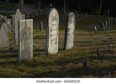 Hancock, New Hampshire, USA - October 14, 2007: Old headstones highlighted by late afternoon sun