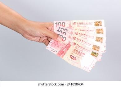 hand with 5 HongKong 100 Dollars banknote