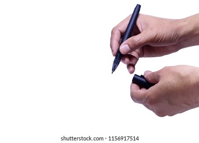 a hand of adult holding a black pen and pen's cover on white background isolated