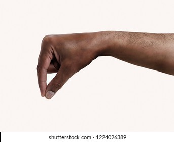 hand of an African man hanging something isolated on white