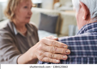 Hand of aged supportive wife on shoulder of her sick or stressed husband during support, sympathy or caregiving