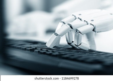 hand of a ai robot is using the keyboard of an computer