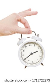 Hand with an alarm clock in a hand. Isolated on white background. Close up